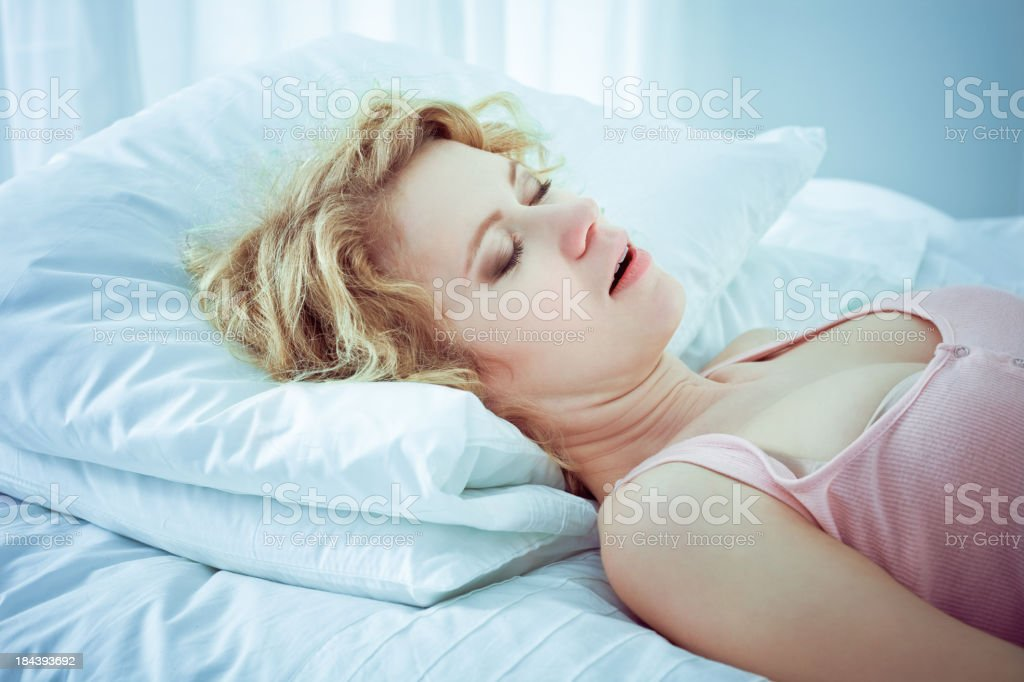 Snoring woman Beautifull young adult woman sleeping in a bad with mouth open and snoring, 20-24 Years Stock Photo