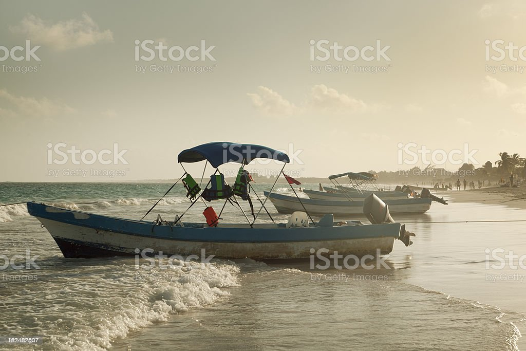 Snorkeling and Scuba Diving Boats in Tulum Beach stock photo