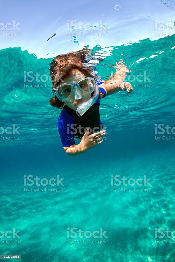 Snorkeling boy stock photo