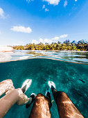 Young adult couple snorkeling in Maldives sea