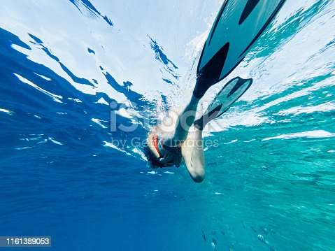 Young adult woman snorkeling in Maldives sea