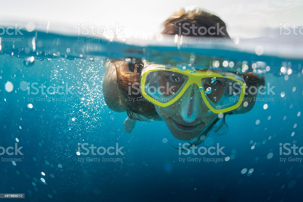 Snorkeling in the ocean stock photo
