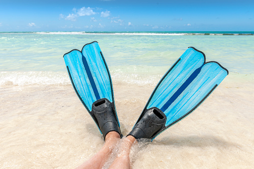 Snorkeling in turquoise water of the Keys, Florida.. Concept of luxury lifestyle. Active water sport.