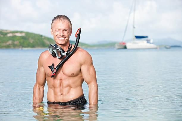 Snorkeling Man on Sailboat Vacation stock photo