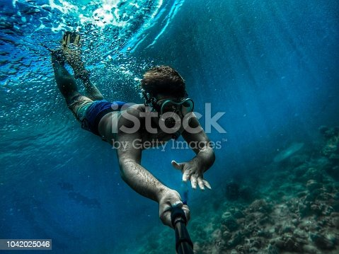A Japanese man is enjoying Snorkeling