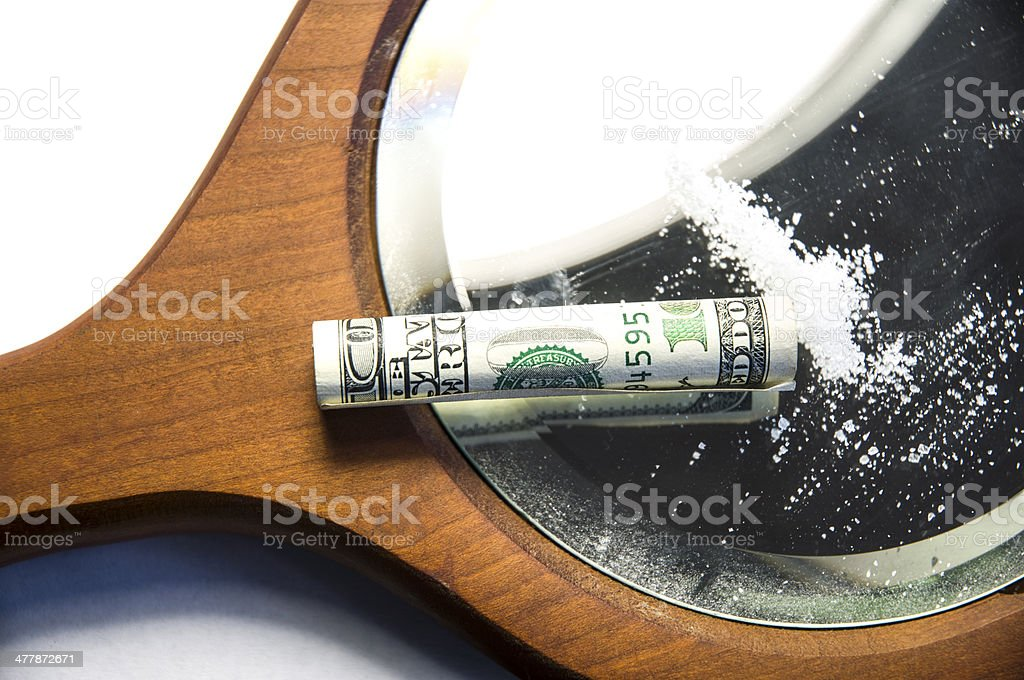 Snorting Cocaine Or Meth On A Mirror With Dollar Bill royalty-free stock photo