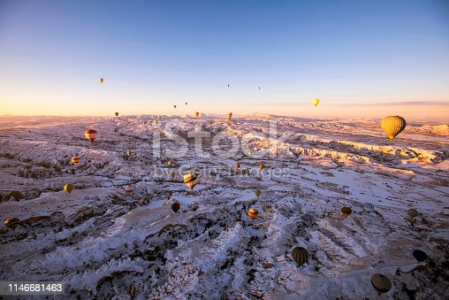515376634 istock photo Snow and Air Balloon Cappadocia 1146681463