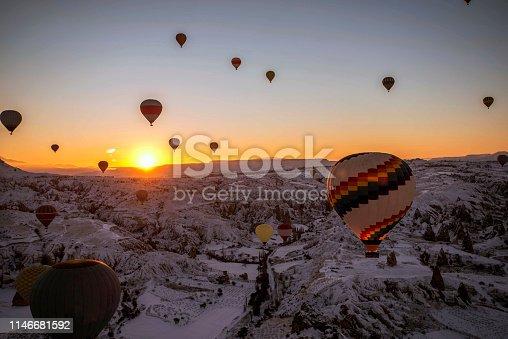 515376634 istock photo Snow and Air Balloon Cappadocia 1146681592