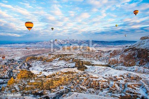 515376634 istock photo Snow and Air Balloon Cappadocia 1146681685