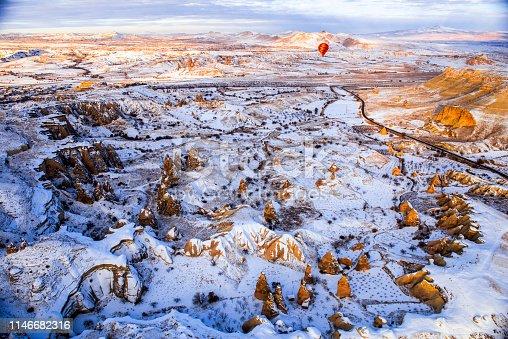 515376634 istock photo Snow and Air Balloon Cappadocia 1146682316