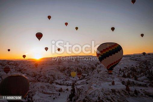 515376634 istock photo Snow and Air Balloon Cappadocia 1146682936