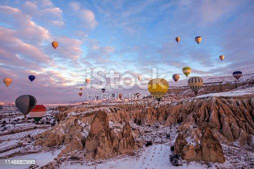515376634 istock photo Snow and Air Balloon Cappadocia 1146682993