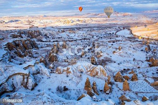515376634 istock photo Snow and Air Balloon Cappadocia 1146683129