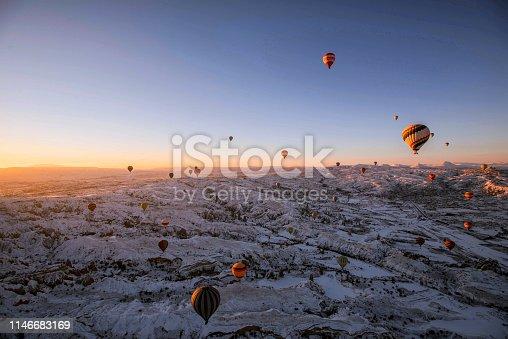 515376634 istock photo Snow and Air Balloon Cappadocia 1146683169