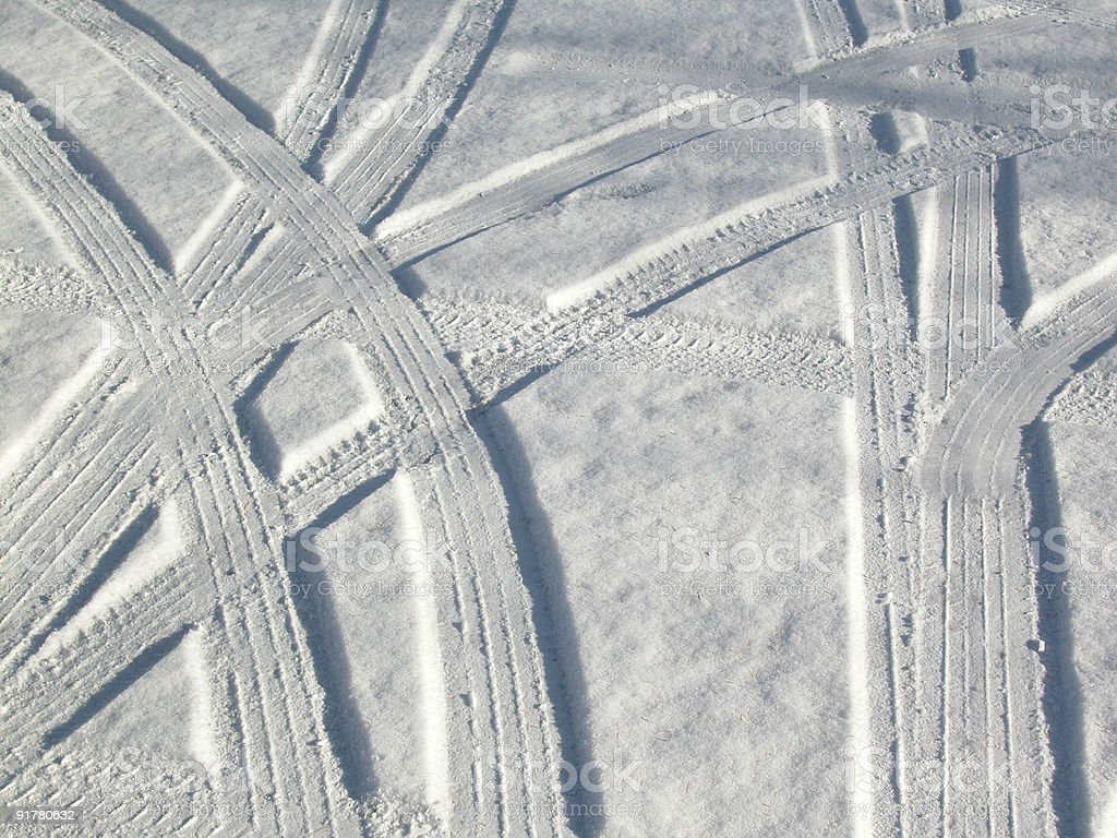 Snow and car tracks in an abstract pattern royalty-free stock photo