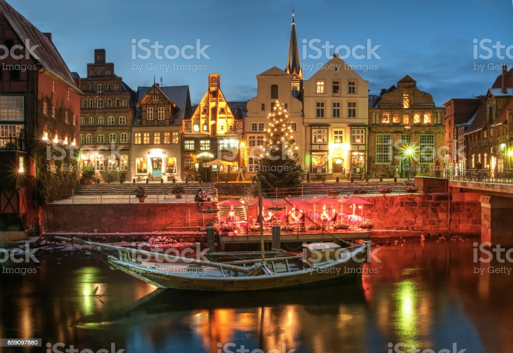 Snow and Christmas scenery by night, Lüneburg stock photo