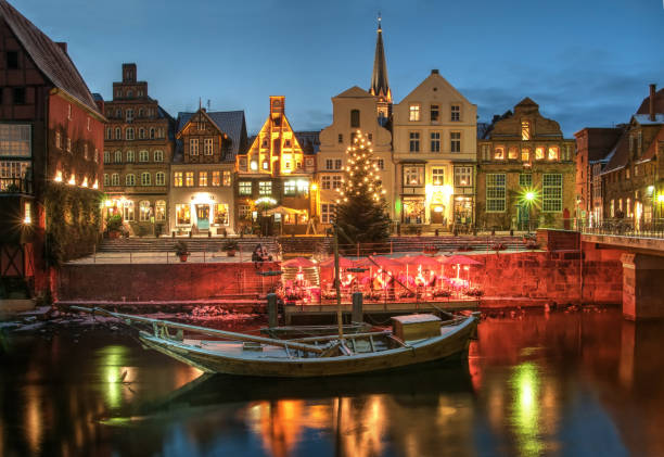 Snow and Christmas scenery by night, Lüneburg Snow and Christmas scenery by night, Lüneburg, near Hamburg, Germany. lüneburg stock pictures, royalty-free photos & images