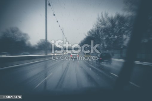 istock Snow and rain on highway 1295213170