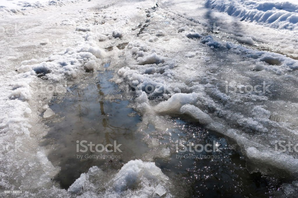 Snow and slush melting stock photo