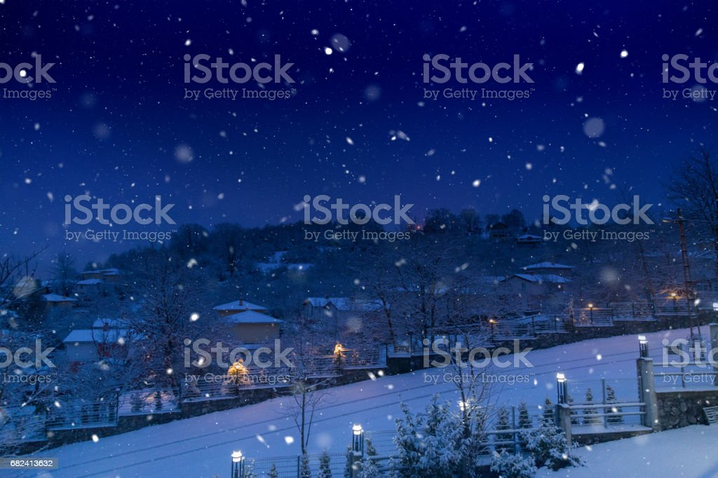 Snow and village houses royalty-free stock photo