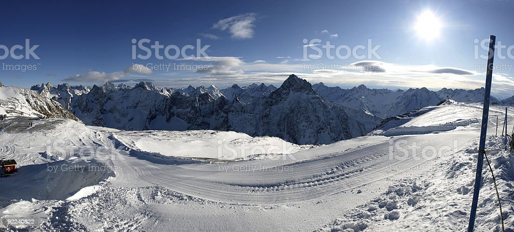 snow and winter panorama of 2 Alps with sun Ecrins stock photo