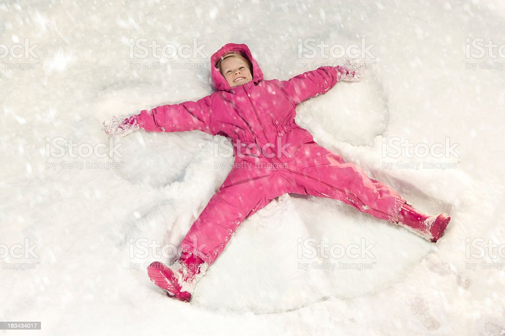 Snow angel in the snowfall stock photo