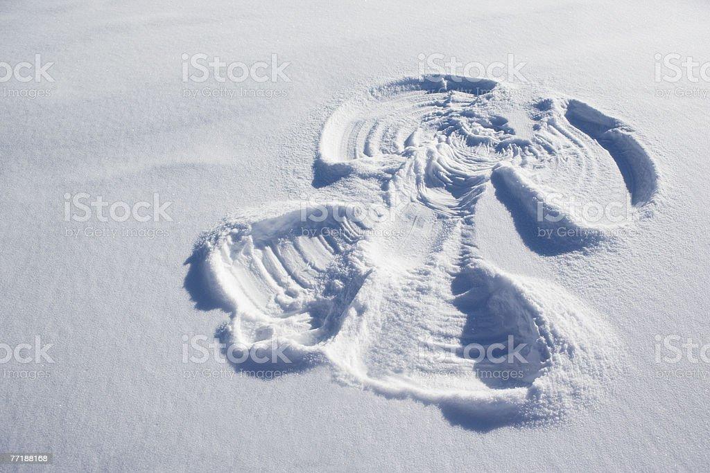 A snow angel stock photo