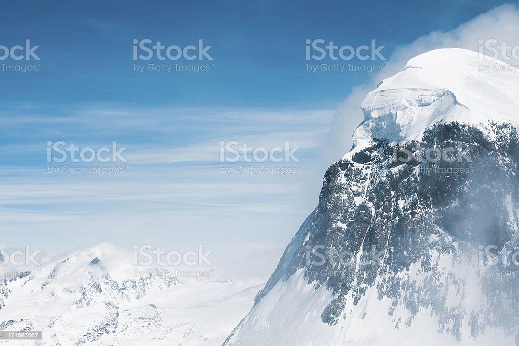 Snow at mountain peaks stock photo