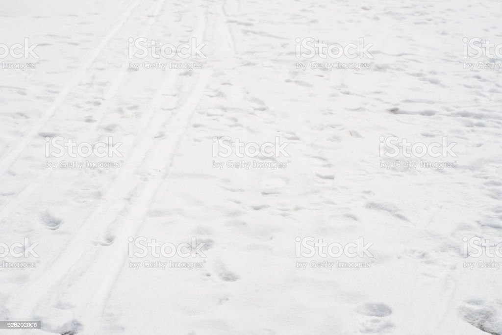 snow background  with ski traces adn foot prints stock photo