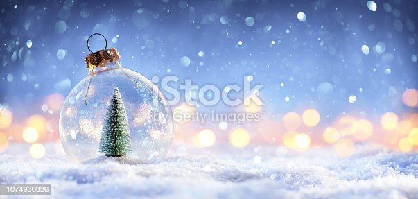 istock Snow Ball With Christmas Tree In It And Lights On Winter Background 1074930336