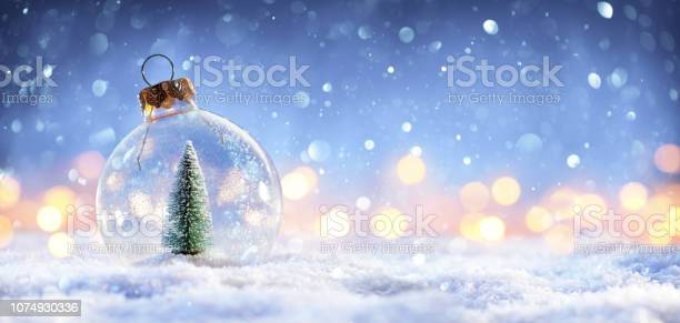 Snow ball with christmas tree in it and lights on winter background picture id1074930336?b=1&k=6&m=1074930336&s=612x612&h=ddb4wvgbsledov7nmgoww tkf3rgo8066s8hlcfokoc=