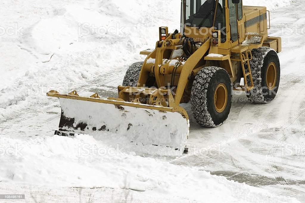 Snow Be Gone! huge plow clearing parking lot after storm royalty-free stock photo