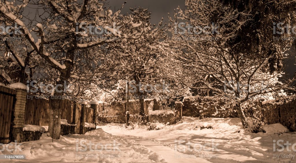 Snow beautiful winter night on the countryside. Street view with snow...