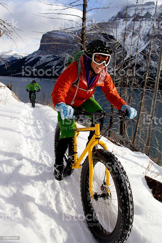 Snow Biking Couple stock photo