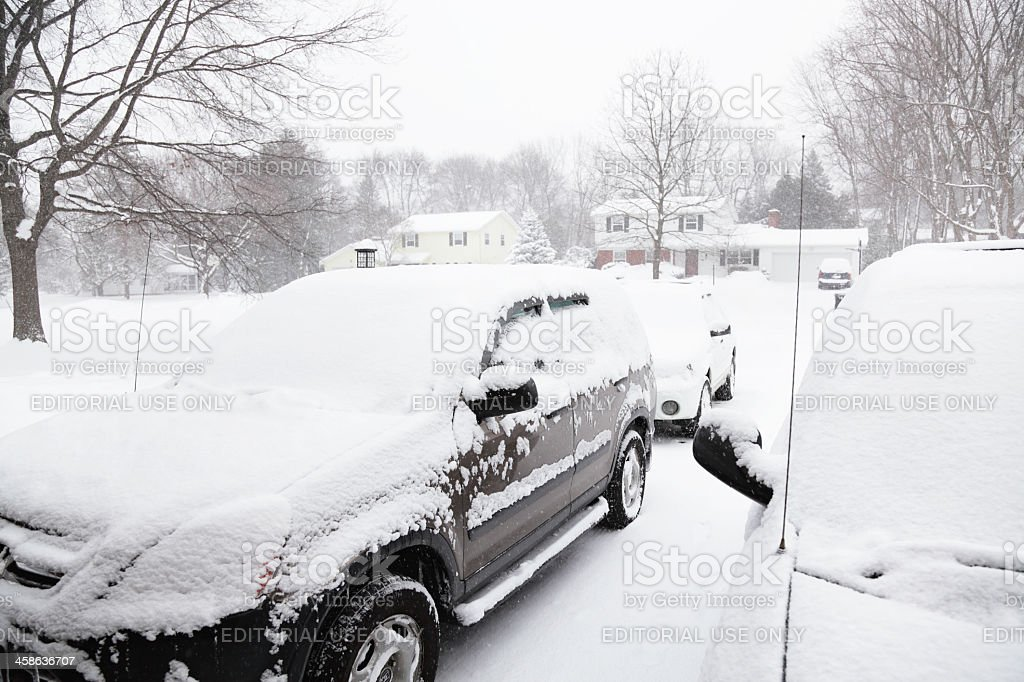 Snow Blizzard Cars in Driveway stock photo