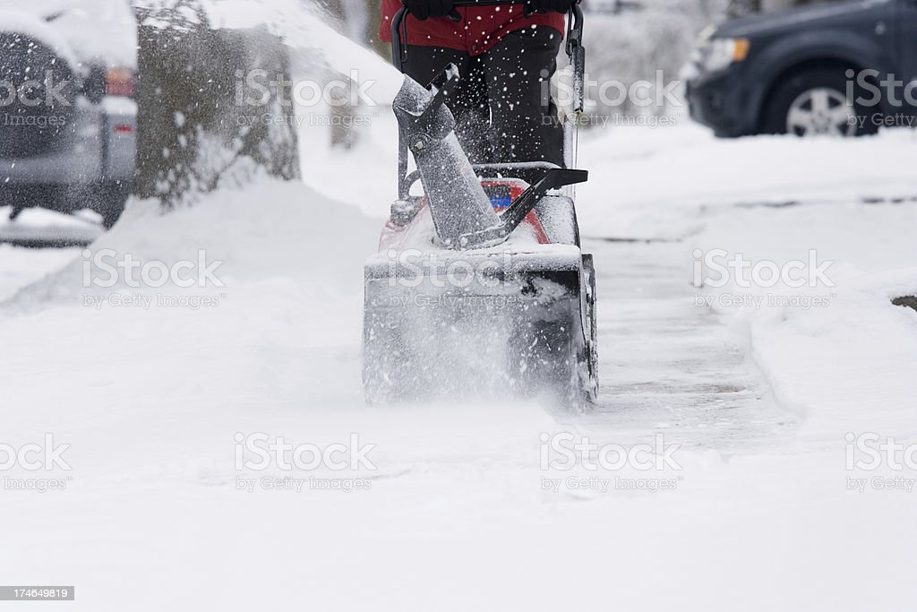 Snow blower at work stock photo