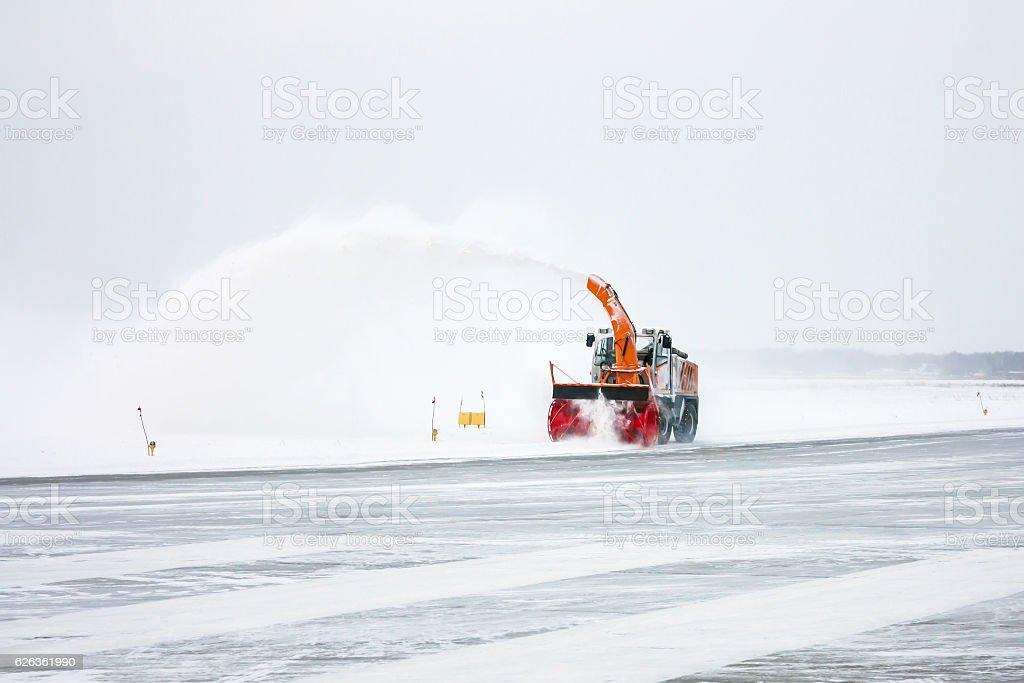 Snow blower cleans runway стоковое фото