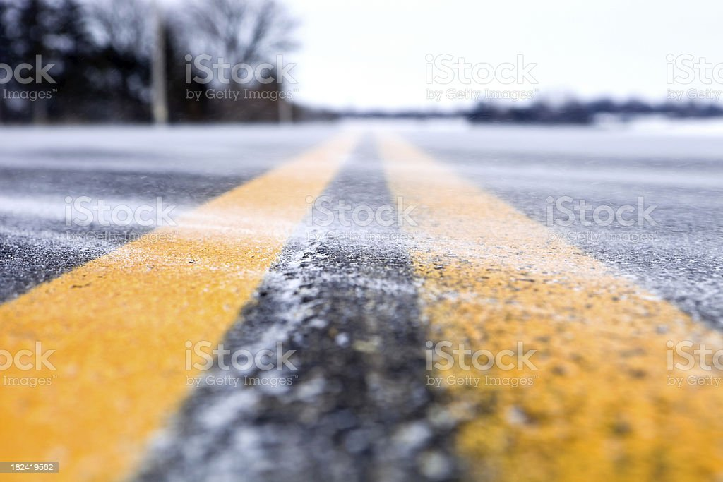 Snow Blowing Across a Winter Two Lane Road royalty-free stock photo