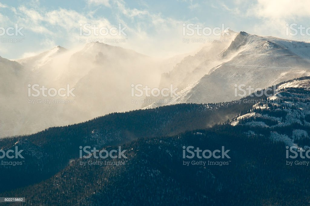 Snow Blowing in Morning Light Pikes Peak stock photo