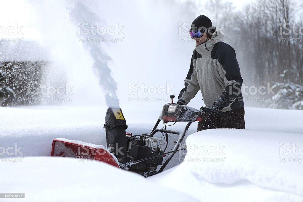 snow blowing man stock photo
