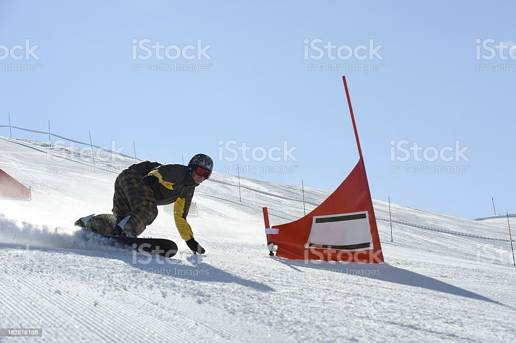 Snow boarder at the red gate stock photo