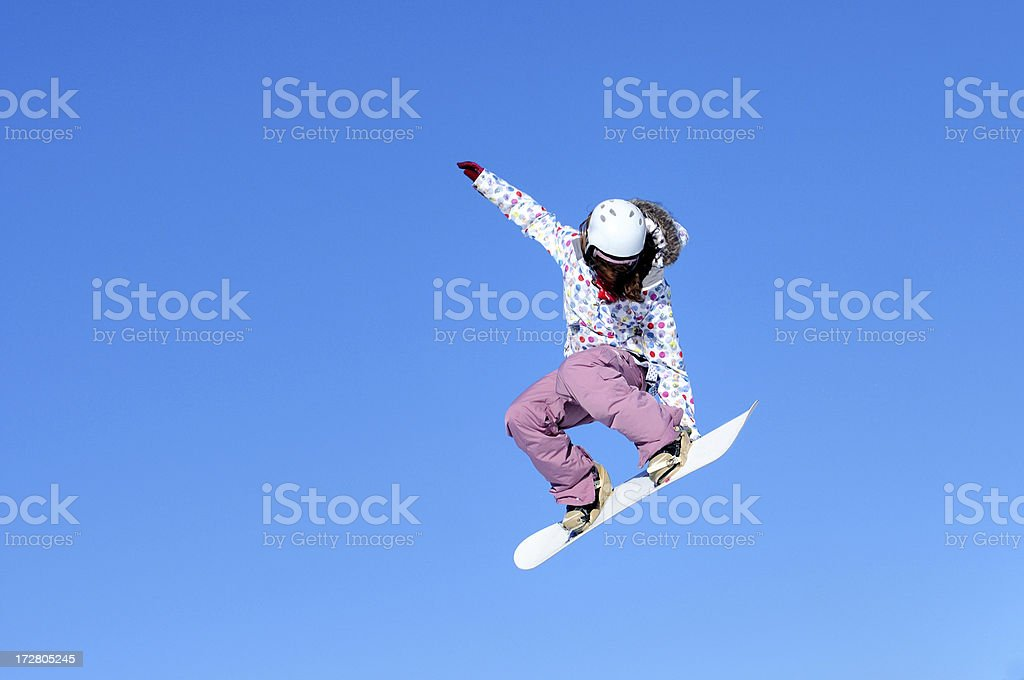 Snow boarder flying stock photo