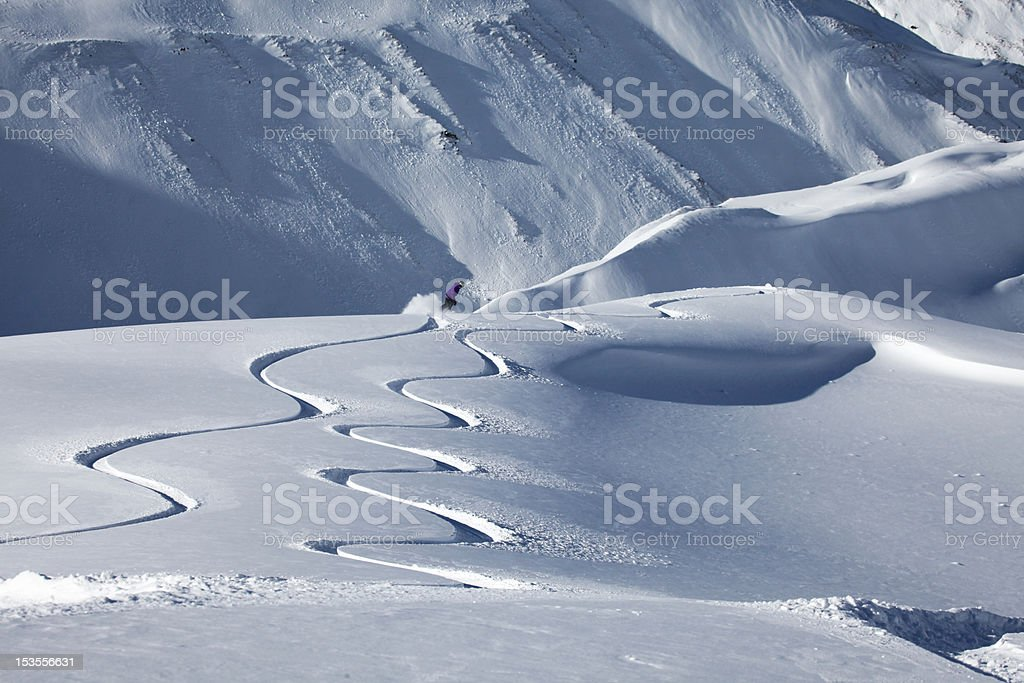 Snow Boarder in fresh powder, New Zealand stock photo