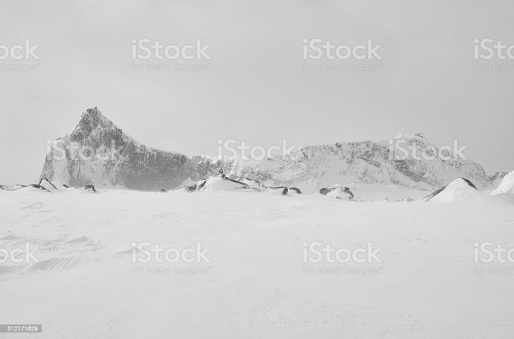Snow, boulders and a mountain ridge in Jotunheimen National Park stock photo