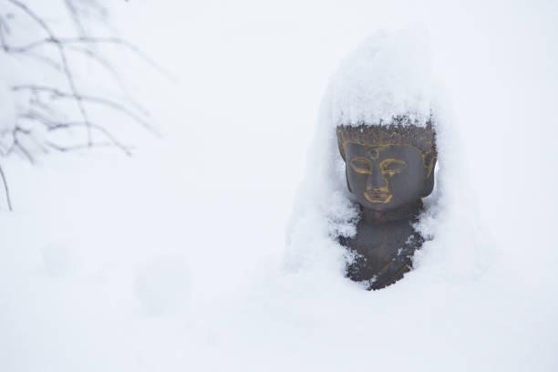 Snow Buddha stock photo