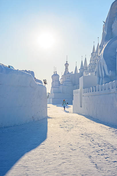 Snow building Harbin, China - January 11, 2015: Snow building. People are visiting. 27th China Harbin Sun Island International Snow Sculpture Art Expo. Located in Harbin City, Heilongjiang, China. harbin stock pictures, royalty-free photos & images