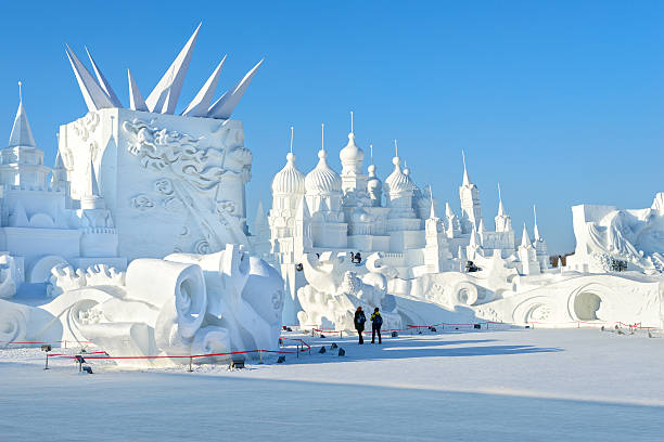 Snow building Harbin, China - January 11, 2015: Snow building. People are visiting. 27th China Harbin Sun Island International Snow Sculpture Art Expo. People are visiting. Located in Harbin City, Heilongjiang, China. harbin stock pictures, royalty-free photos & images