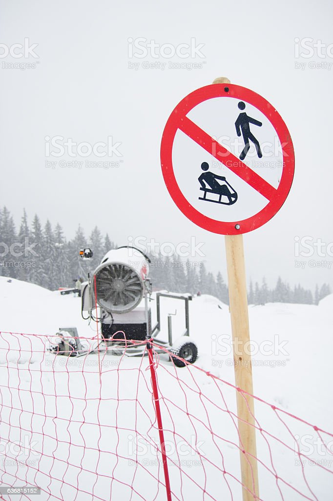 snow cannon being used to cover a mountain stock photo