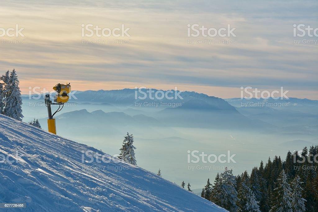 snow cannon in winter mountain stock photo
