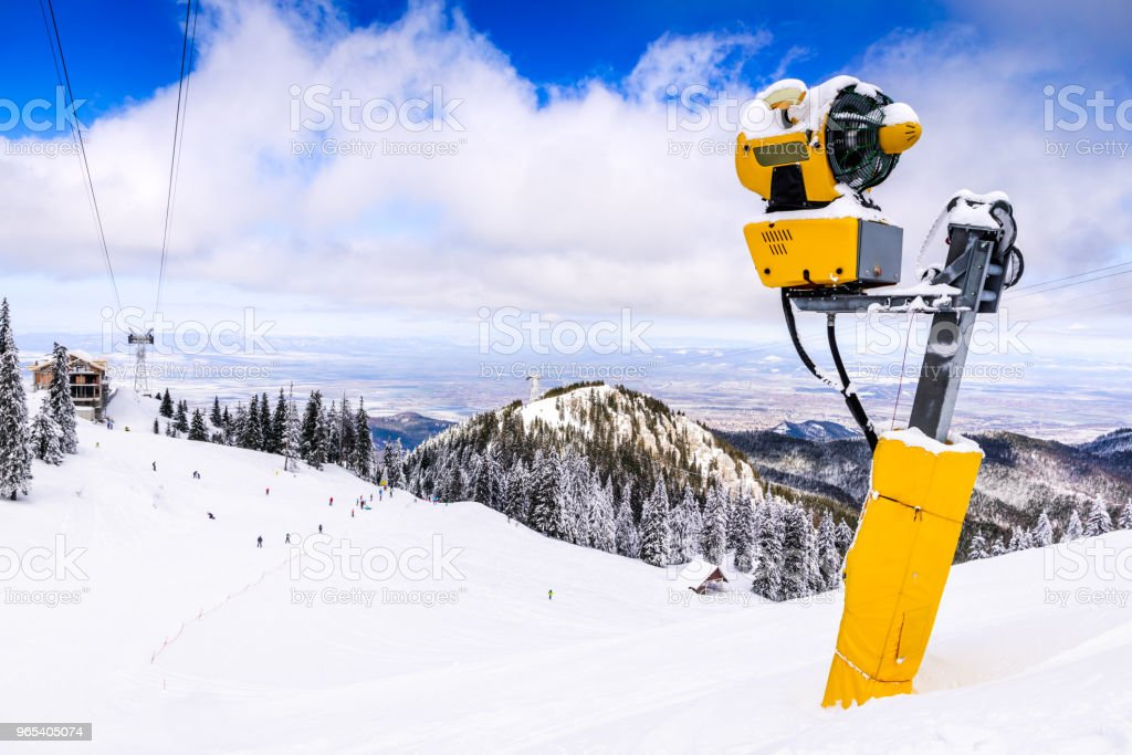 Snow cannon on ski slope, Poiana Brasov, Romania royalty-free stock photo